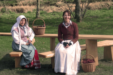 All Ability wooden Picnic Table Bench with ladies in historical costumes