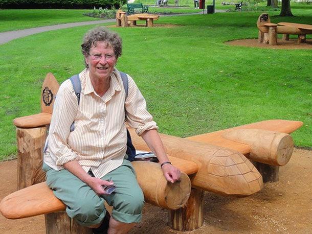 lady sitting on Bristol Blenheim wooden aircraft