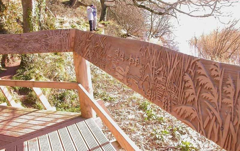 Hand rail carved with wildlife view