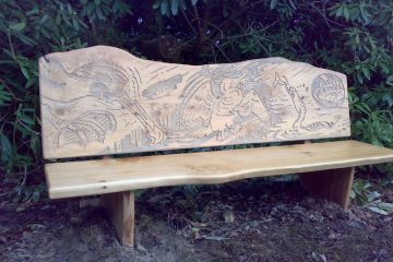 Wooden carved bench engraved with Cormorant artwork