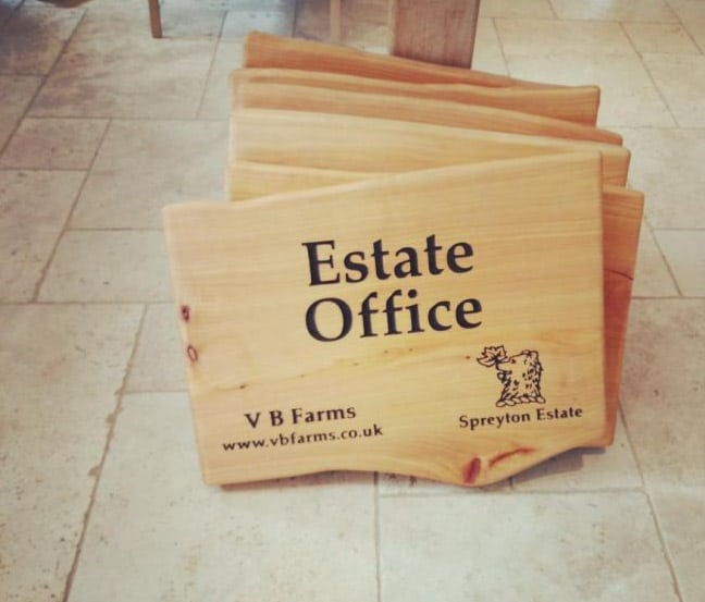 etched branded wooden estate signs