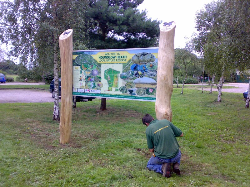 man installing large welcome sign