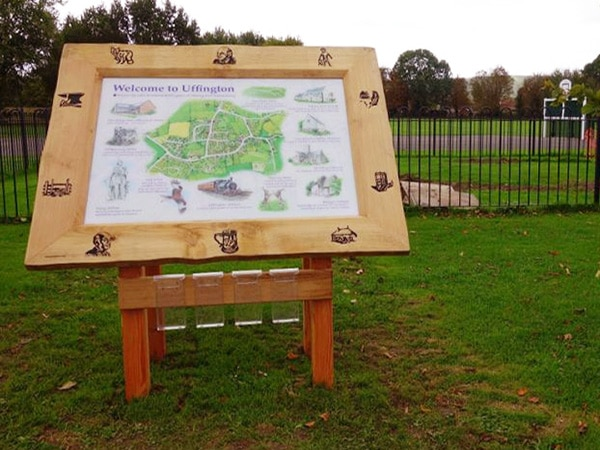 information map housed in a large wooden carved frame