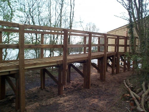 raised wooden boardwalk to elevated bird hide Emberton Country Park