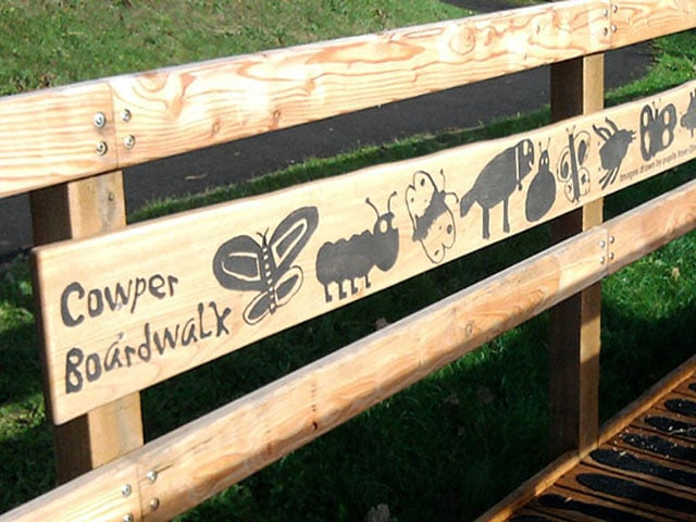 Boardwalk rail etched artwork