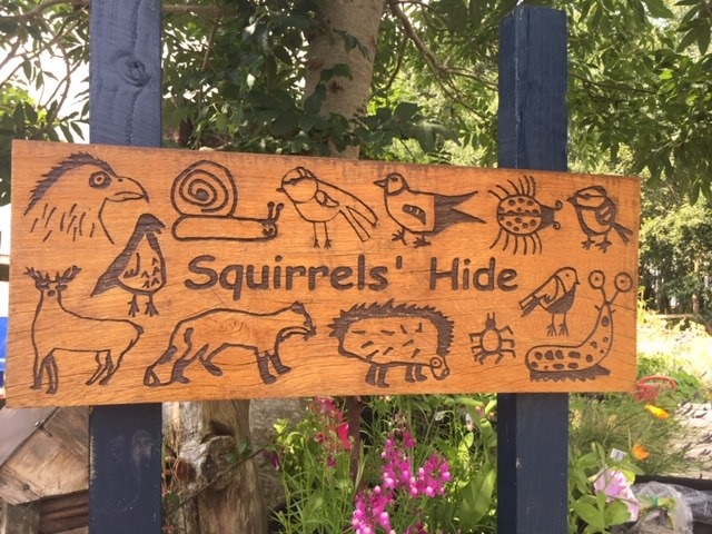 Playground sign with children's animal drawings
