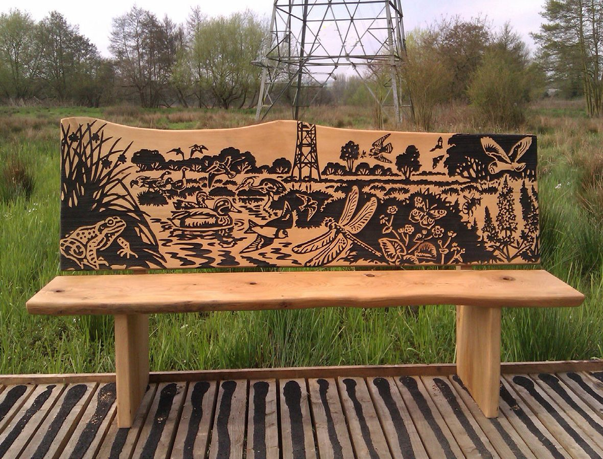 Wooden bench with local wildlife view carved into the backrest